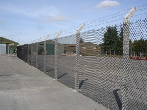 Chainlink fencing with barbed wire on commercial site
