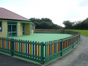 wooden school fencing around playground