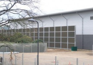 Acoustic fencing surrounding school