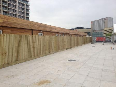 Closeboard timber fencing surrounding wooden property