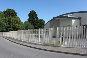 white painted palisade fencing around school