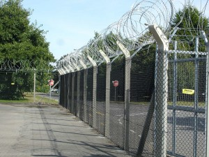 chainlink fencing with barbed wire on top