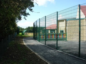Rigid mesh fencing surrounding school playground